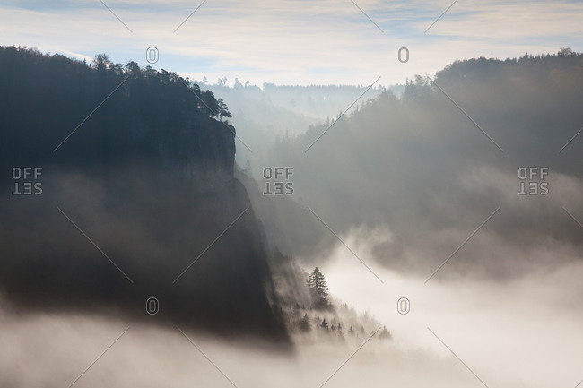 Ascending mist at the rocks in the valley of the Danube river