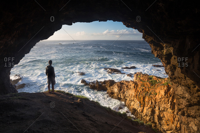Person watching the waves at The Heads, Indian Ocean, Knysna, Western cape, South Africa