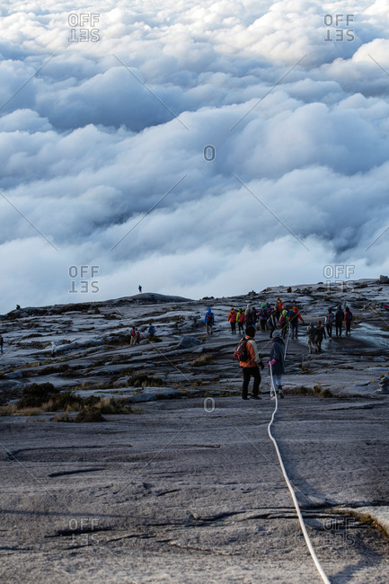 Mountain Tourists climbing down from the Low's Peak, Mount Kinabalu, Borneo, Malaysia