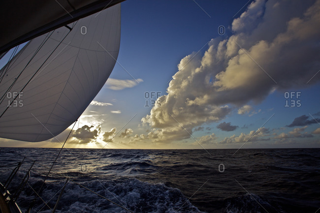 Sailing boat, yacht on the Atlantic ocean with trade wind clouds, Sailing