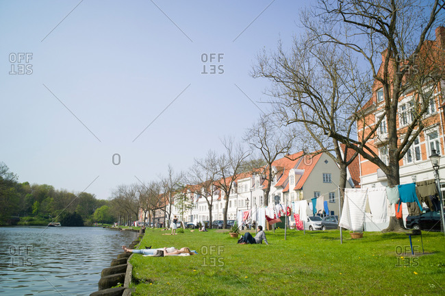 Lawn along the river Trave, Lubeck, Schleswig-Holstein, Germany