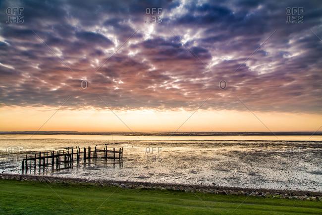 Cloudy sky over the Wadden sea, Amrum Island, North Frisian Islands, Schleswig-Holstein, Germany