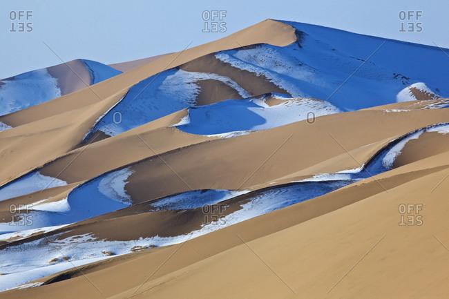 snow-covered sand dunes of the Khongoryn Els in the Gobi desert, Mongolia