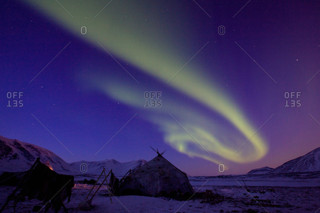 Aurora, aurora borealis, over the Yarangas of Reindeer nomads