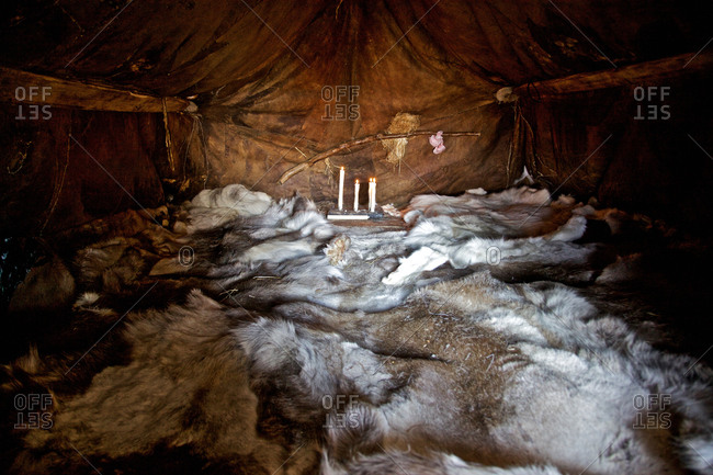 A sleeping area in a Yaranga with reindeer skins,