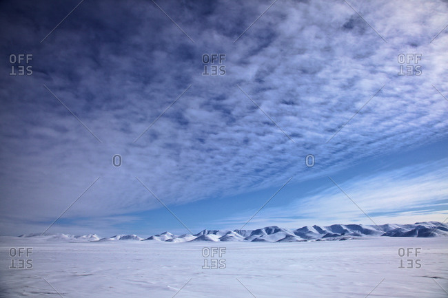 Cirrus clouds over the Zolotoy Khrebe mountains