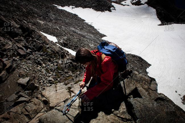 Women climbing in rocks, descent from Habicht 3277 m, Stubai Alps, Tyrol, Austria