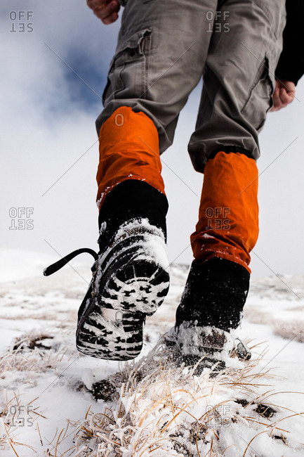 Hiker walking in snow, ascend to Unnutz Mountain