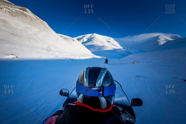 Man on snowmobiles through Spitzbergen, Svalbard, Norway