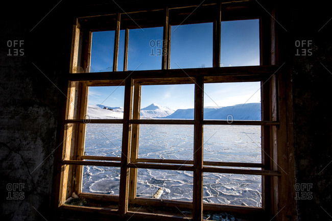 Arctic sea with ice at Spitzbergen through a window
