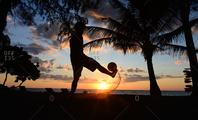 Sunset at Long Chao Beach, person playing with a football, Island of Kut, Golf of Thailand, Thailand