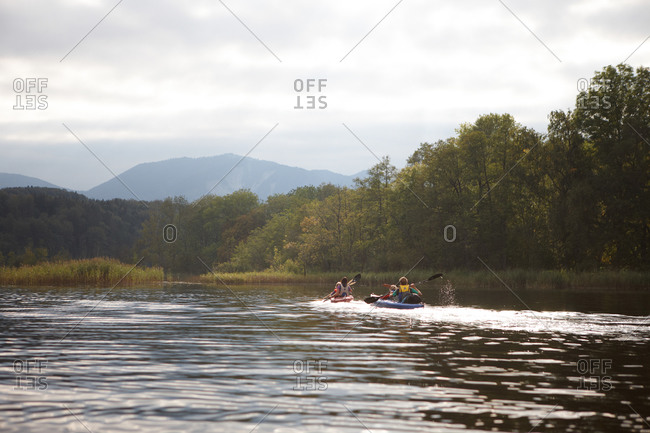 Family canoe touring on lake Staffelsee