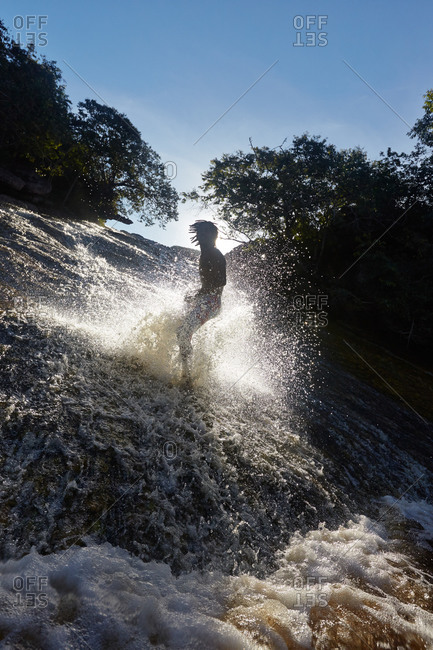 Waterfall surfer on the river Ribeirao do Meio