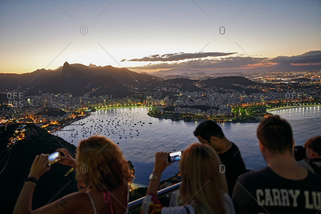 Visitors taking pictures from Sugar Loaf Mountain in Rio de Janeiro