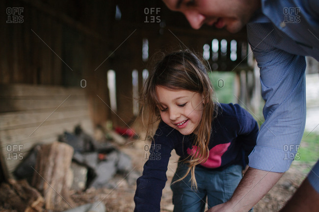 Close up of a girl and her dad in a shed