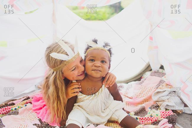Girl hugging baby sister