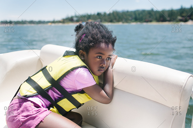 Girl riding on a boat