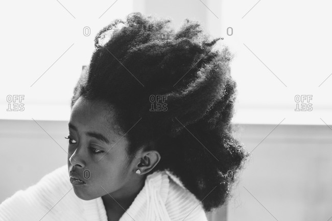 Black and white portrait of a girl with her hair sticking up