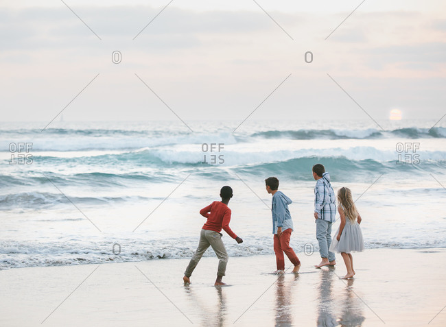 Children watching the waves from the beach