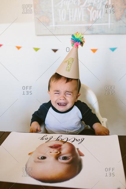 Sad baby on his first birthday