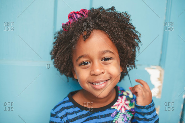 Portrait of a little girl with curly hair