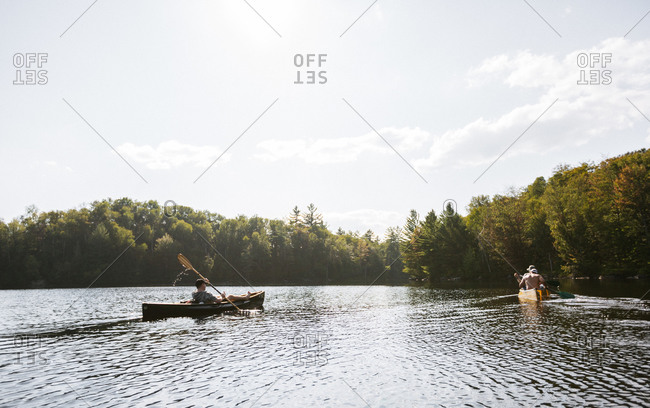 People canoeing in a lake in Upstate, New York
