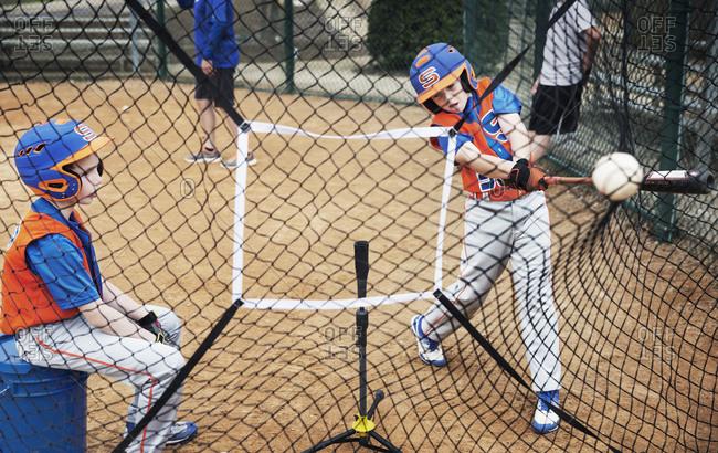 Boys playing baseball on field
