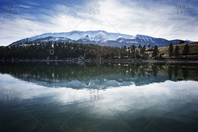 Idyllic view of Wallowa Mountains by lake during winter