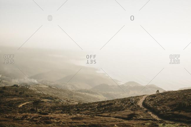 Hazy view of a mountainous coastline in Portugal