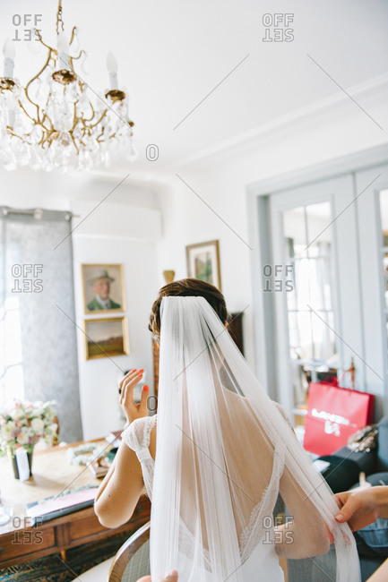 Bride wearing her veil while getting ready on her wedding day