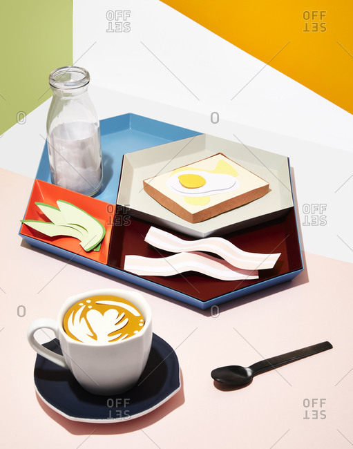 Tray of breakfast food with coffee cup and bottle of milk