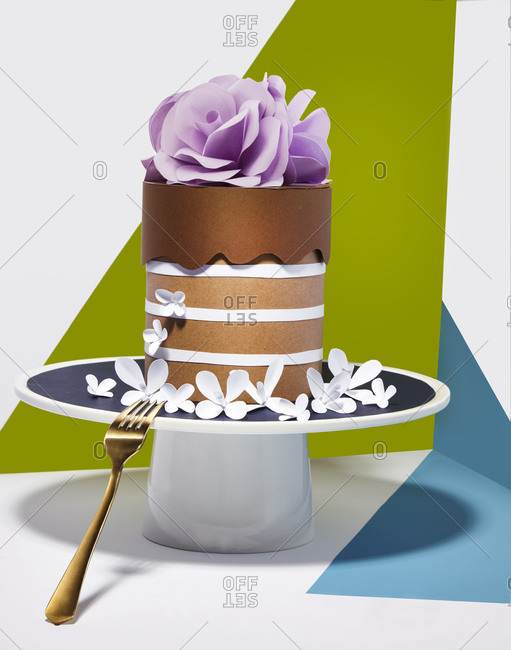 Multilayered cake topped with purple rose