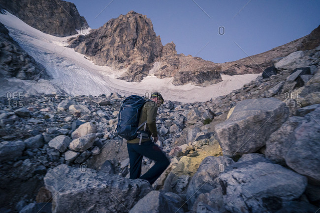 Man hiking and climbing the Grand Teton in Grand Teton National Park, Wyoming
