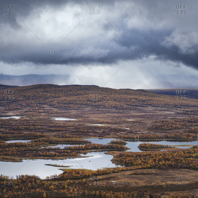 Islands and autumn colors of lake Tarnasjon, Kungsleden trail, Lapland, Sweden