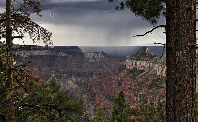 A view of lightning striking near a plateau along the Widforss trail at the Grand Canyon National Park