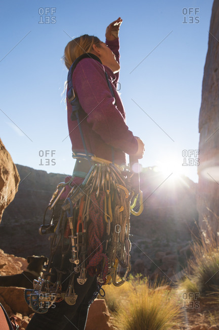 A woman looking up at her next climbing route, Moab, Utah