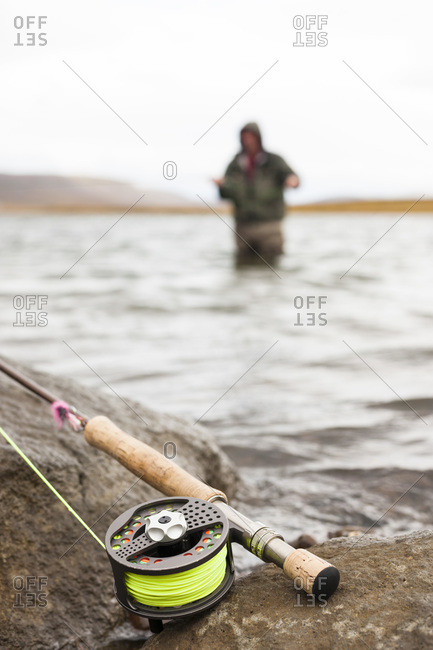 Man fly fishing on the river Grmsa, Iceland