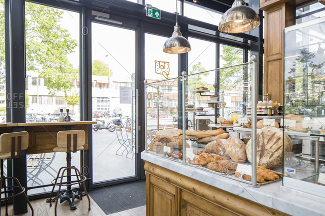 Amsterdam, The Netherlands - May 20, 2015: Fresh bread and baked goods behind a glass partition at a Danish bakery