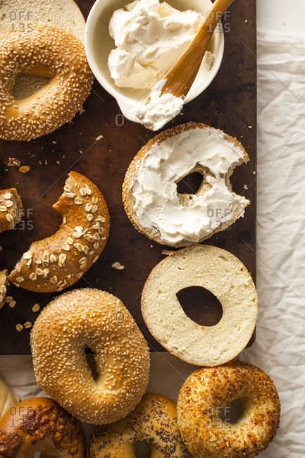 Bagel with cream cheese missing a bite