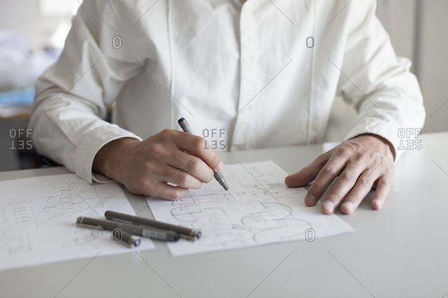 Close up of an architect student sketching