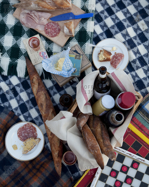 Picnic foods and board games spread out on blankets