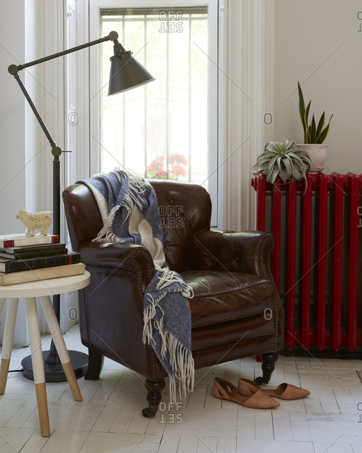 Leather chair with blanket and lamp