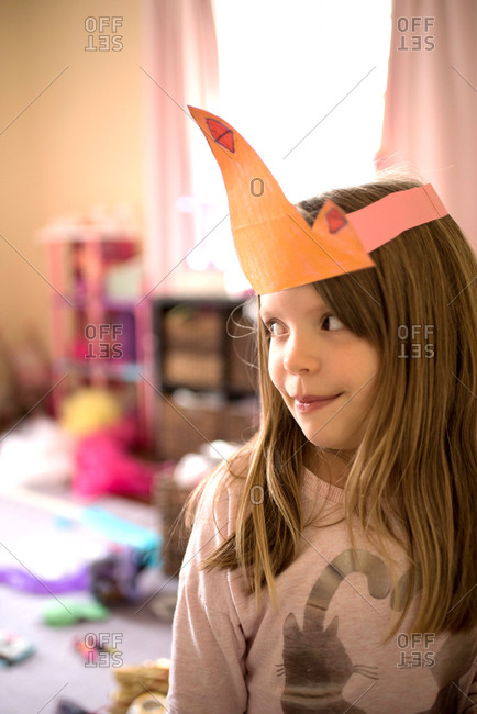 Little girl with paper princess crown