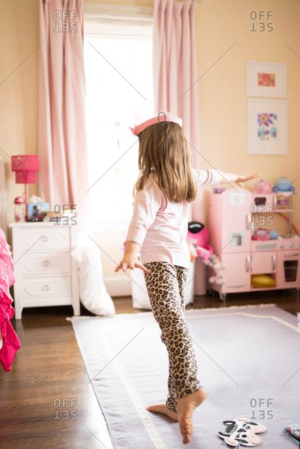 Girl twirling in her bedroom