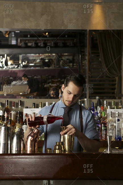 Buenos Aires, Argentina - June 26, 2015: Bartender pouring drink in Buenos Aires