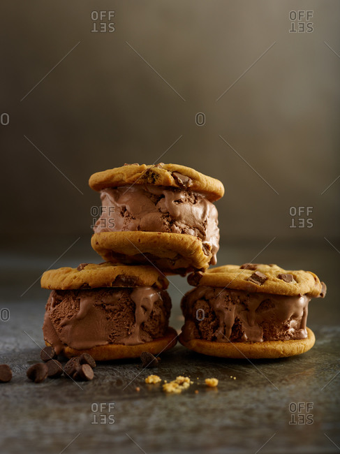 Ice cream sandwiches made with chocolate ice cream and chocolate chip cookies