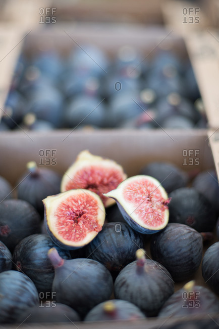 Split fig on box of fresh figs for sale at market