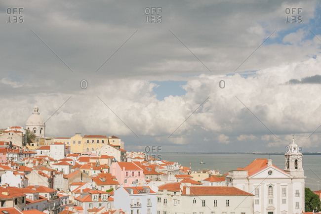 Churches and terra cotta roofed buildings on hillside in Lisbon, Portugal