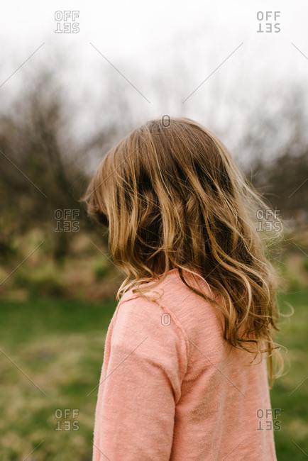 Girl in cardigan in rural setting