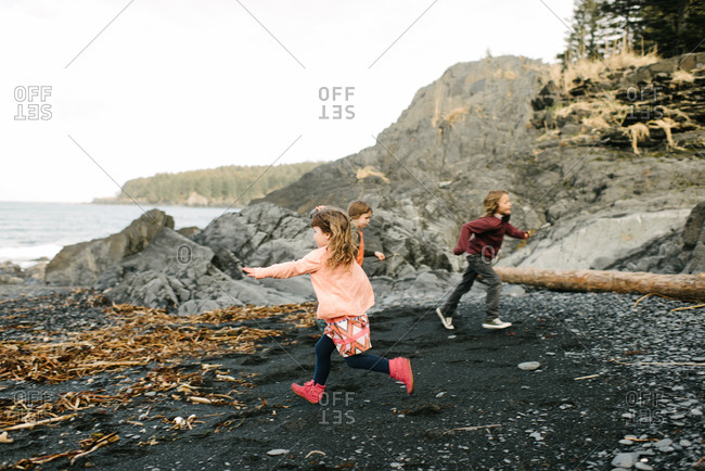 Kids running on remote beach